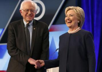 Democratic presidential candidates, Hillary Clinton and Sen. Bernie Sanders shake hands before the start of the Univision, Washington Post Democratic presidential debate at Miami-Dade College on March 9 in Miami, Fla.