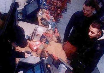 Mohamed Abrini (top right) is seen with Salah Abdeslam in this image taken from a CCTV camera at a gas station north of Paris on Nov. 11, 2015. Wanted for questioning over both the Paris attacks and the recent bombing of the Brussels airport, Abrini was arrested Friday.