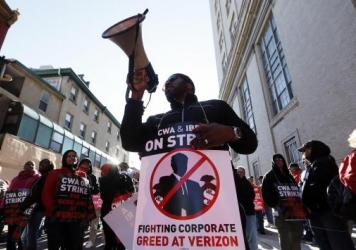Verizon workers picket outside one of the company's facilities in Philadelphia Wednesday. Verizon landline and cable workers on the East Coast walked off the job Wednesday morning after little progress in negotiations since their contract expired nearly