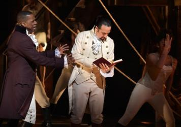 Actor Leslie Odom, Jr. (left) and actor, composer Lin-Manuel Miranda (right) perform on stage during the <em>Hamilton</em> Grammys performance.