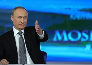 Russian President Vladimir Putin gestures while answering a question during his annual televised call-in show in central Moscow on Thursday.