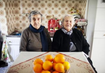 """The mothers of Militsa Kamvysi, 83, (left) and Maritsa Mavrapidou, 85, arrived on the Greek island of Lesbos nearly a century ago as refugees from what was then the Ottoman Empire (now Turkey). """"We welcomed refugees because we're descended from refugees, too,"""" Mavrapidou says."""
