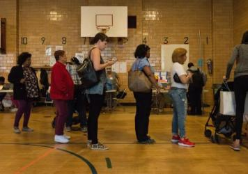 People line up to check in to their voting station at Public School 22 in Brooklyn on Tuesday.