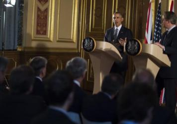 President Obama talks with Britain's Prime Minister David Cameron at a press conference in London Friday.