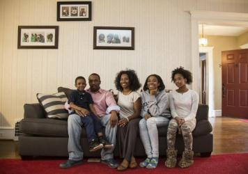 "The Miller family sits in the living room of their home in a Philadelphia suburb. They are part of an ongoing lawsuit, arguing Pennsylvania has neglected its constitutional responsibility to provide all children a ""thorough and efficient"" education."