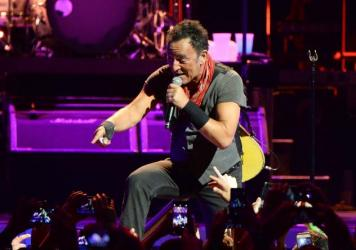 "At the Barclays Center in Brooklyn on Saturday night, Bruce Springsteen and the E Street Band paid tribute to Prince with a cover of ""Purple Rain."""