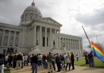 LGBT-rights supporters take part in a rally outside the Capitol in Jefferson City, Mo., on March 31. An amendment to the state Constitution protecting people who object to same-sex marriage failed in a committee vote on Wednesday, effectively killing the