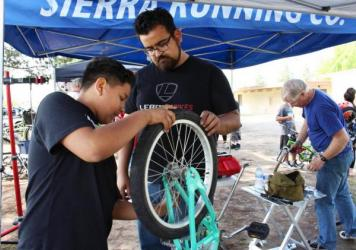 Eloise Betancourt brought her 11-year-old son, Lorenzo (right) to the Fresno, Calif., community event to learn to repair his bike. Lorenzo saved money from his lawn-mowing business, his mom says, to buy bikes at a garage sale for himself and his sisters.