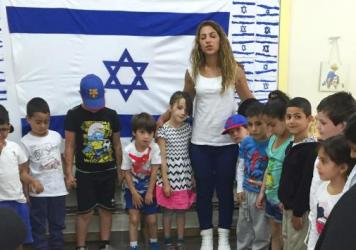Kindergarten teacher Nava Ron says she's always explained a little bit about Holocaust Remembrance Day to help her students understand what is happening around them. She tells children it was part of a war a long time ago and far away, and she focuses on