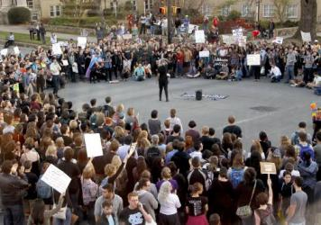 Hundreds attend a rally in Chapel Hill, N.C., on March 29 to protest the passage of House Bill 2. The state of North Carolina and the U.S. Justice Department are suing each other over the law's restriction on protections for lesbian, gay, bisexual and tr