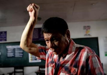 Philippines presidential front-runner and Davao City Mayor Rodrigo Duterte arrives at the voting precinct to cast his vote at a high school in Davao City on Monday.