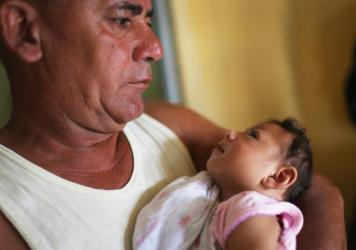 This 3-month-old baby, born with microcephaly, is held by her father in Recife, Brazil.