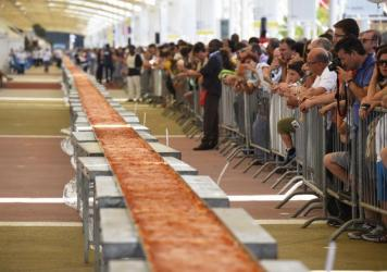 Last June, Milan swiped the record for world's longest pizza with a 1.5-kilometer pie. Naples is not amused — and it's cooking up its vengeance.