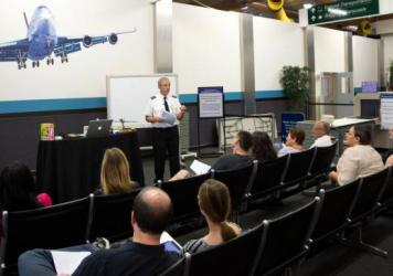 """Ron Nielsen, a retired airline pilot, tells his class of fearful fliers in Southern California that crying can be a useful emotional release. If that's what they need to do, he tells them, """"let 'er rip!"""""""
