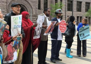 Protesters gathered outside the federal courthouse in Minneapolis where three young Somali-Americans are on trial for allegedly planning to go to Syria to join the Islamic State. The demonstrators say the FBI and local law enforcement is targeting and en