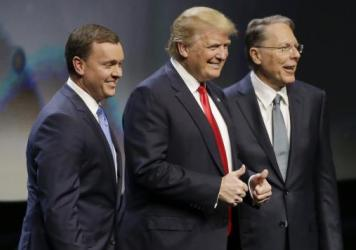 Donald Trump is introduced by National Rifle Association executive director Chris Cox (left) and NRA executive vice president Wayne LaPierre on Friday at the organization's convention in Louisville, Ky.