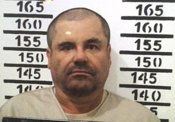 """Mexico's most wanted drug lord, Joaquin """"El Chapo"""" Guzmán, stands for his prison mug shot at the Altiplano maximum security federal prison in Almoloya, Mexico."""