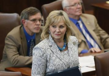 Oklahoma Gov. Mary Fallin walks on the floor of the Oklahoma House on Wednesday. On Friday, Fallin vetoed legislation that would make it a felony for doctors to perform an abortion.