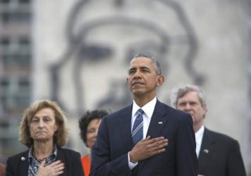 "President Obama listens to the U.S. national anthem in Havana on March 21. Behind him is an image of Cuba's revolutionary leader Ernesto ""Che"" Guevara."