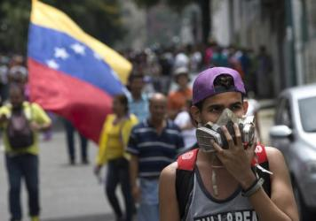 Venezuelan police equipped with riot gear block a street during a demonstration in Caracas on May 18.