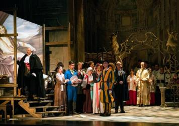Michael Chioldi (far left) as Baron Scarpia in a January production of Puccini's <em>Tosca</em> by the newly reformed New York City Opera.