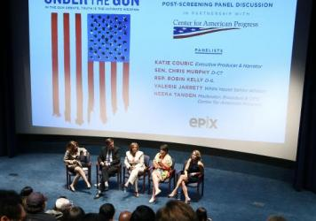 Katie Couric (right) and White House Senior Adviser Valerie Jarrett, speaking, participate in a panel discussion following a May 16 screening of Couric's documentary <em>Under the Gun</em>  at the U.S. Navy Memorial in Washington.