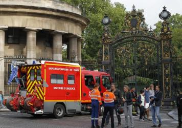 A fire truck is parked at the entrance to Monceau parc in the center of Paris, France, on Saturday, after a lightning bolt crashed down onto a Paris park, striking 11 people at a child's birthday party.