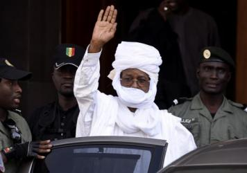 Hissene Habre, the former president of Chad, waves as he leaves a courthouse in Dakar, Senegal, on June 3. Habre was ousted from Chad in 1990 and has lived in exile in Senegal ever since.