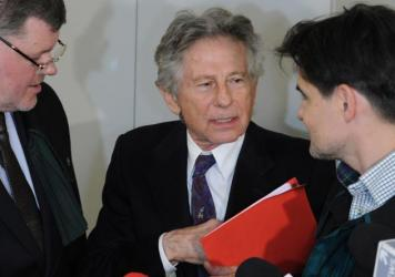 Director Roman Polanski speaks to his lawyers after a February 2015 hearing concerning a U.S. request for his extradition in Krakow, Poland.