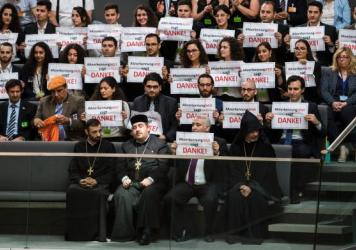 Germans with Turkish roots protest before the German Parliament on Wednesday, expressing their opposition to a resolution to recognize as genocide the killing of Armenians by Ottoman Turks starting in 1915. The resolution passed overwhelmingly on Thursda