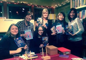 Linda Johns, lower row center, in the first moments of her heart attack. She's with fellow authors Kristen Kittscher, Kirby Larson, Suzanne Selfors, Sara Nickerson and Jennifer Longo at Queen Anne Book Company in Seattle.