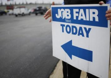 A Job News USA employee directs job seekers to a career fair at Papa John's Cardinal Stadium in Louisville, Ky., on May 18. New figures from the Bureau of Labor Statistics show that the number of workers who would like to work full-time but can find only