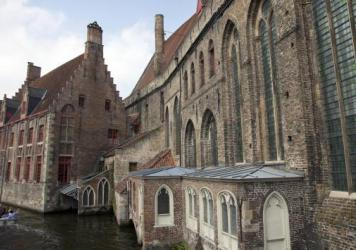 Tourists ride in a boat down a main canal in Bruges, Belgium. A brewery in the historic city is building a pipeline to send thousands of gallons of its beer to a bottling plant without clogging narrow cobblestone streets.