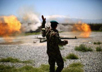 A member of the Afghan army looks on as an artillery gun fires at Taliban fighters in the hills of Nangahar Province, in eastern Afghanistan, in 2015. NPR photographer David Gilkey, who was killed Sunday, embedded with the Afghan military on multiple occasions to see how it was faring in its fight against the Taliban.