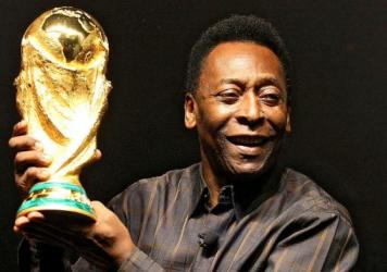 Brazilian soccer star Pele displays the FIFA World Cup during its presentation in Rio de Janeiro in February 2010. Pele's World Cup winner's medals from 1958, 1962 and 1970 are up for auction.