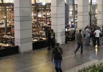 Israeli security forces gather at a shopping complex in Tel Aviv following a shooting attack in a market and restaurant district on Wednesday.