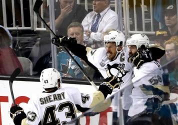 Kris Letang of the Pittsburgh Penguins celebrates his goal in the second period with Sidney Crosby and Conor Sheary.