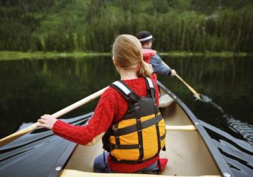 Canoes, water, mosquitoes — what would summer camp be without them? This year, bug spray will also be in the mix.