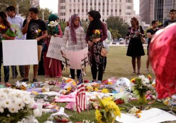 Young people from Husseini Islamic Center in Sanford, Fla., visit a makeshift memorial at the Dr. Phillips Center for Performing Arts on Tuesday in Orlando.