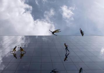 The vertical dance troupe BANDALOOP performs suspended from a Boston office building.