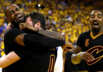 LeBron James and Kevin Love of the Cleveland Cavaliers celebrate after defeating the Golden State Warriors 93-89 at Oracle Arena on Sunday in Oakland, Calif.