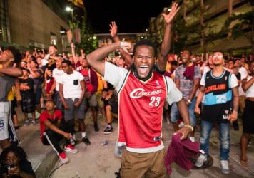 Cleveland Cavaliers fans celebrate in the street after the win.