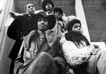 """Bootsy Collins (top left), Grady Thomas (3rd from left), George Clinton (4th from left), (bottom row) Calvin Simon, Ray Davis, Bernie Worrell, Fuzzy Haskins, Michael Hampton of the funk band """"Parliament-Funkadelic"""" pose for a portrait in circa 1977."""