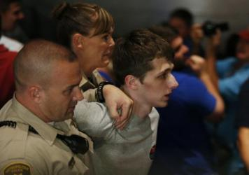 Police remove a protester, later identified as Michael Steven Sandford, who wanted to shoot Republican presidential candidate Donald Trump, at the Treasure Island hotel and casino on Saturday in Las Vegas during a Trump rally.