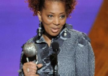 Terry McMillan accepts the award for outstanding literary work, fiction, for <em>Getting to Happy</em> at the 42nd NAACP Image Awards in 2011 in Los Angeles.