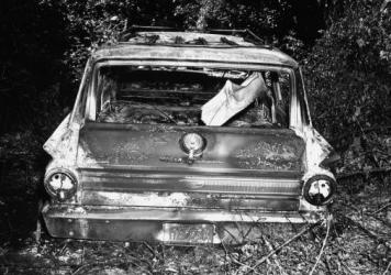 In this picture released by the FBI and the State of Mississippi Attorney General's Office, the burned-out station wagon that slain civil rights workers James Chaney, Andrew Goodman and Michael Schwerner were driving in is seen in June 1964 in the Bogue