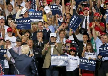 Donald Trump points to a roaring crowd of supporters during a speech Saturday in Phoenix, Ariz.