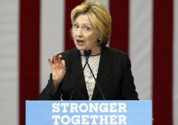 Hillary Clinton highlighted women's participation in the workforce and took on Donald Trump's economic record during a speech in Ohio on Tuesday.