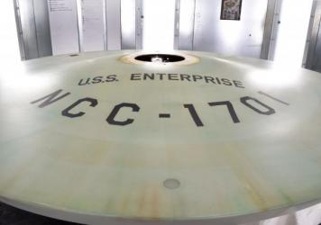 Just one part of the 11-foot-long and 200-pound model, the secondary hull of the USS Enterprise will be restored to its original green hue.