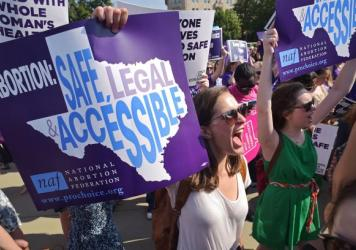 Abortion-rights activists chant outside the U.S. Supreme Court ahead of a historic ruling Monday striking down a Texas law that imposed strict requirements on clinics that perform abortions.